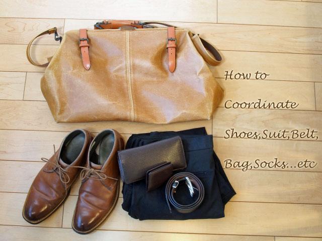革靴とスーツ、ベルト、バッグ、ネクタイ